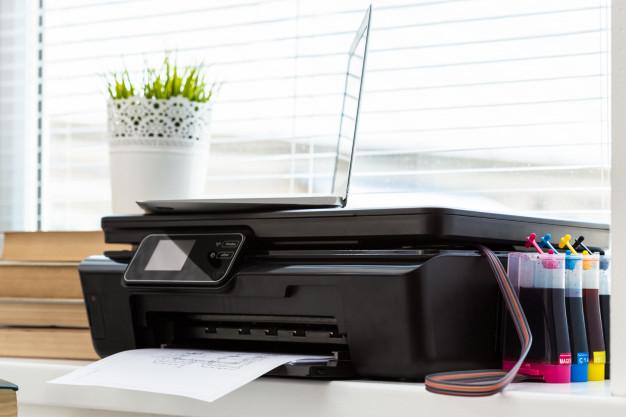 Realize a conexão da impressora com a rede utilizada